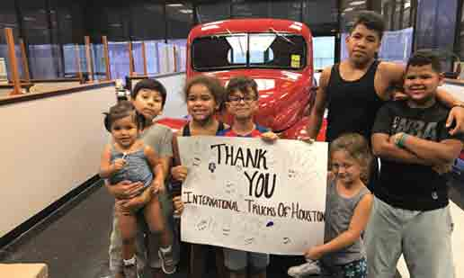 Bunch of children displaying Thank You